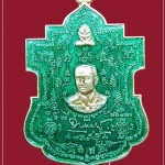 เหรียญกรมหลวงชุมพรฯ-หลวงปู่ทวด นั่งทับปืนคาบศิลา รุ่นพระเจ้ากำบังตน เนื้อกะไหล่เงินลงยา สีเขียวเหนี่ยวทรัพย์ ปี2553